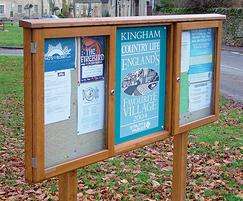 Three-bay oak noticeboard with central sign panel