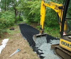 Geoweb being infilled with gravel for forest path