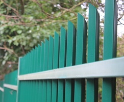 Vertical bar fencing secures golf club perimeter