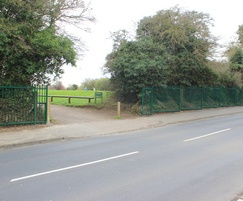 Vertical bar metal fencing around golf course