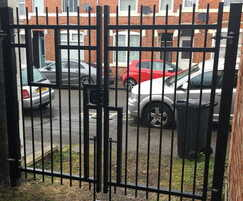 Barbican double-leaf security gate for alley