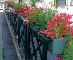 Self-watering planters on railings