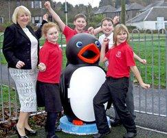 Singing penguin litter bin