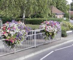 Self-water planters on railings
