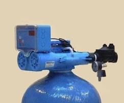 Base exchange water softeners