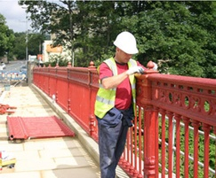 Re fitting the refurbished parapet panels