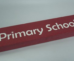 Bespoke text engraved into seat slat for durability