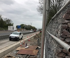 Retaining wall being built along busy M1