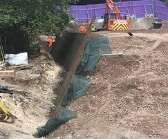 Textomur reinforced soil slope for new school building