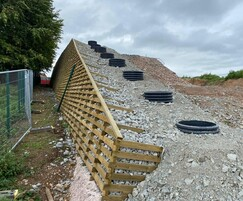 Permacrib retaining wall system