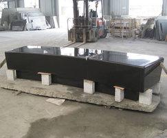 Polished black granite seat in production