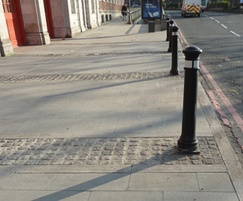 Cropped granite setts and bollards for bay delineation