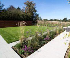 Jubilee Turf with porcelain paving for modern garden