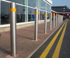 Round stainless steel bollards with tape