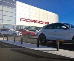 Bollards around Porsche dealership