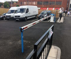 Rising arm barriers restrict vehicular access
