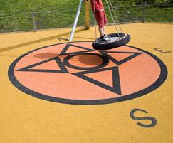 Wet pour safety surfacing
