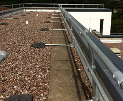 Curved back radiused KeeGuard® guardrail on roof