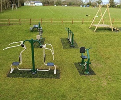 Exercise area with outdoor gym equipment for adults