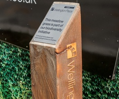 Timber waymarker with metal information plate