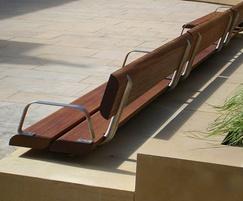 Wall-mounted stainless steel and iroko hardwood bench
