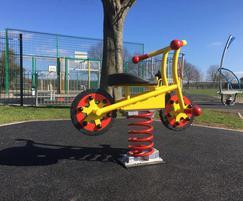 Bike springie for children's play area
