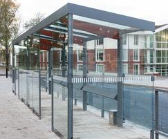 Bus shelter with lean-to seating