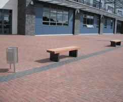 Litter bin and timber framed benches at school