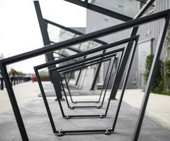 Cycle shelter with robust steel frame and glass