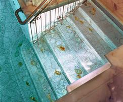 Creatively tiled pool interior and stairs