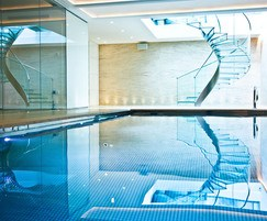 Luxury pool with spiral glass staircase