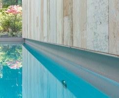 Luxury indoor pool - wood effect stone wall tiles