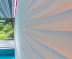 Luxury indoor pool. Wavy wall tiles.