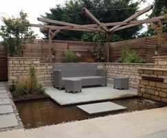 Rear garden seating area with pergola and water feature