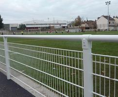 White steel spectator rails with mesh infill