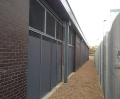 Security fencing with mesh for added protection