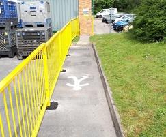 Yellow railings provide walkway barrier