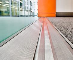 Floor expansion joint cover