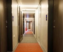 Discreet protection in a hotel corridor