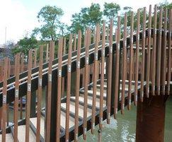 Ekki hardwood spindles fixed to steel truss frame