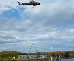 FRP footbridge being installed by helicopter