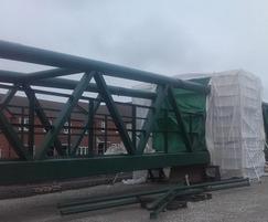 Site welding of footbridge over railway