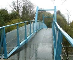 Bespoke steel bridge with glass parapet