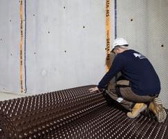 A continuous waterproofing system being installed