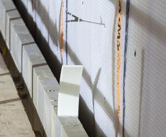 Block wall in front of MS500 with cavity screw ties