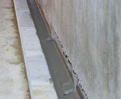 Pipes cast within slab draining water to lower level