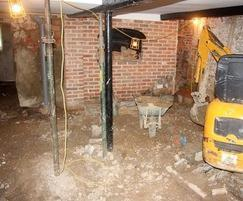 Restoration works including basement waterproofing