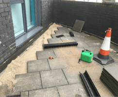 Paving slabs relaid