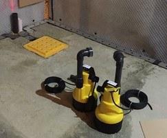 Sump pumps for basement drainage protection