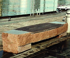 Waterfront rustic granite bench with wooden inlay